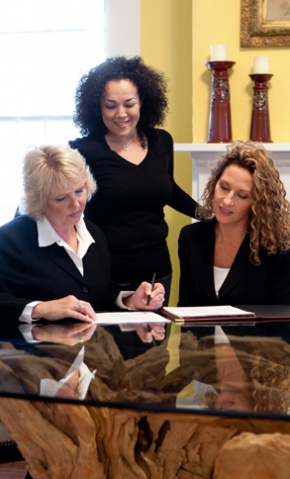 <p>Sherry Rasmus and her legal assistant, Amanda Kazmierski with a client.</p>